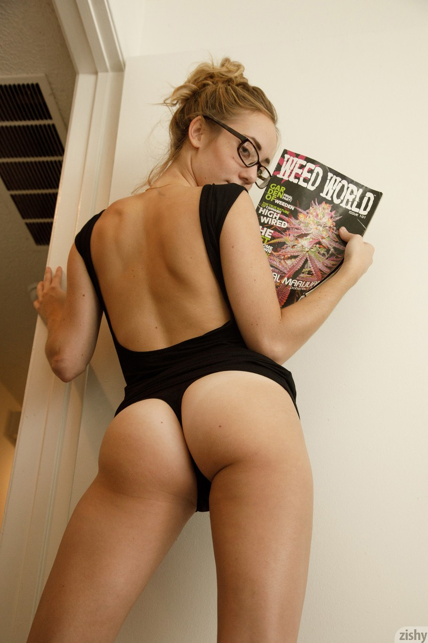 Amateur babe Dallas Mills wears glasses while doing some softcore posing