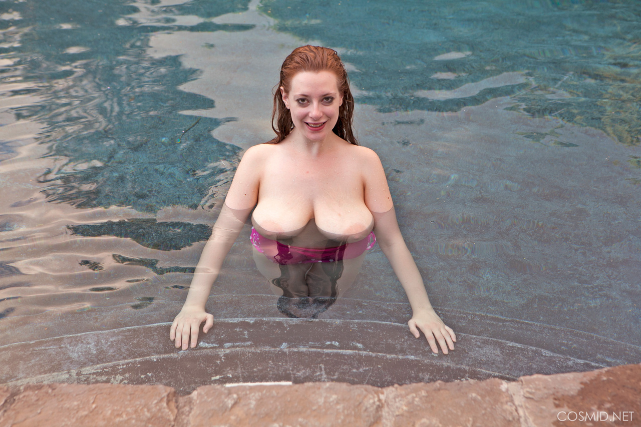 Redhead female Misha Lowe releases her hooters from her bathing suit